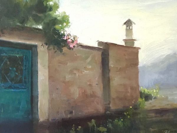 An original oil painting of a landscape titled Pink Roses over a Villager's Wall by Kelli Folsom