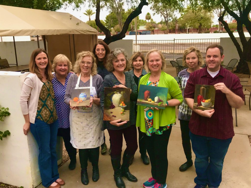 A photo of artist Kelli Folsom with students at Scottsdale Artists School in Scottsdale Arizona