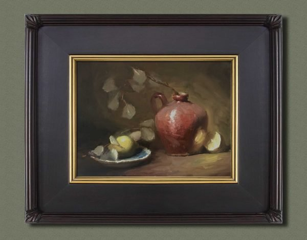 An original framed oil painting of a still life titled Lemons and Old Red by Kelli Folsom