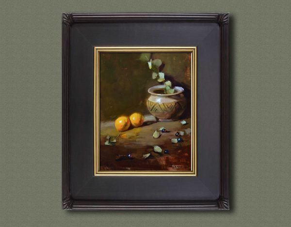 An original framed oil painting of a still life titled Southwest Pot and Oranges by Kelli Folsom