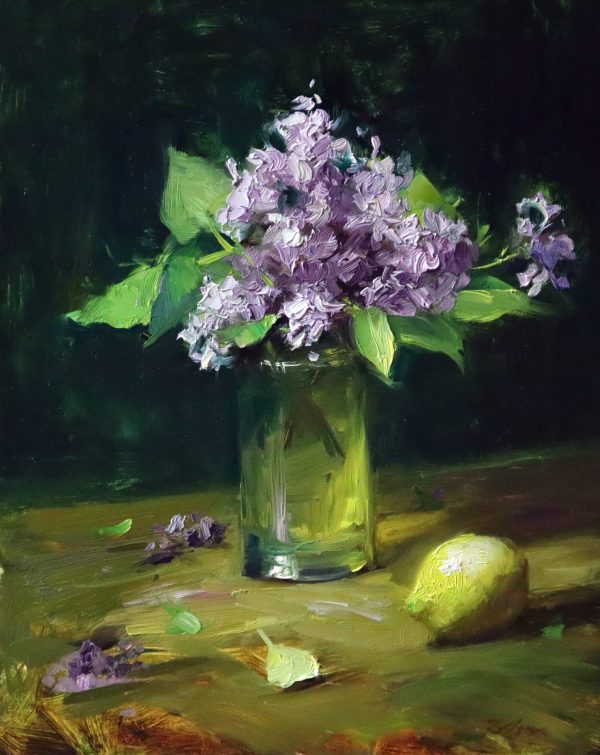 A photo of an original oil painting on panel of a floral still life of lilacs and lemon in a glass vase.