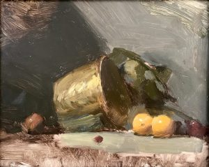 A photo of an original oil painting on panel of a still life painting of a brass bucket and oranges.