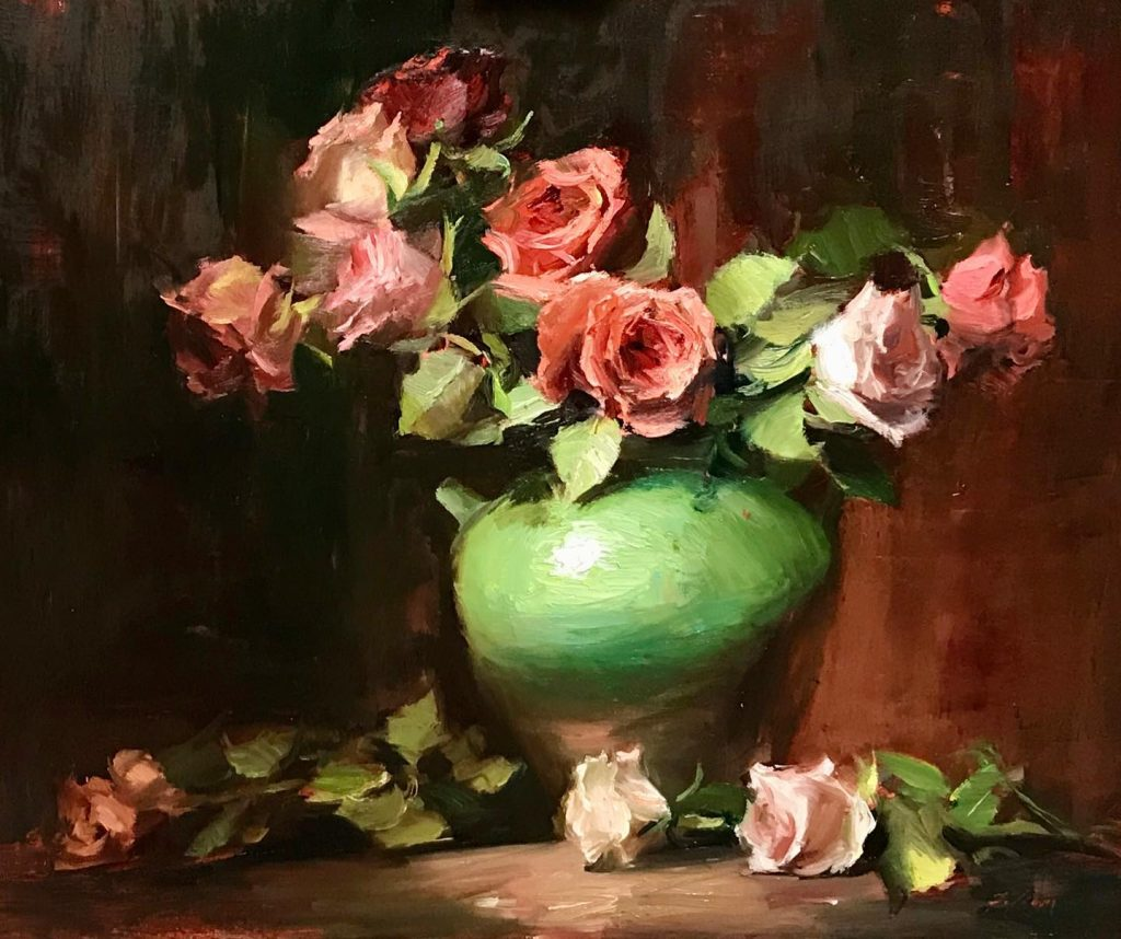 A photo of an original oil painting on panel of a still life painting of red roses in a green jar.