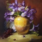 A photo of an original oil painting on panel of a floral still life painting of purple irises in a confit jar and grapes.