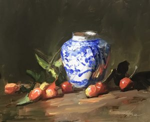 A photo of an original oil sketch on panel of a still life painting of Rainier cherries and a blue and white jar.