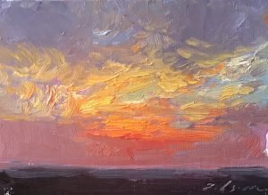 A photo of an original oil painting miniature size by artist Kelli Folsom of a sunrise or sunset in an impressionist style of Denver, CO